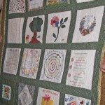 The family quilt, each square made by one of her children or grandchildren