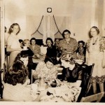Dorothy Kott is 4th from left in back in front of window with print dress on.  Helen Kott Jarvis is shortest one standing in print dress.  Mary Kott (my Great Grandmother) is standing in apron.